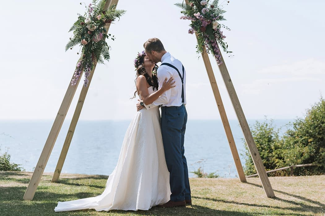 "Image by <a class=""text-taupe-100"" href=""http://www.estradaweddings.co.nz"" target=""_blank"">Estrada Weddings</a>."