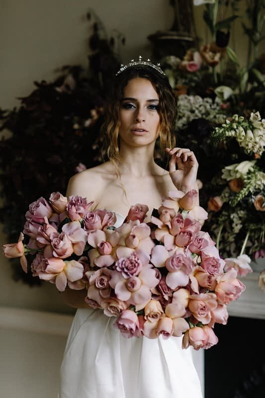 """Image by <a class=""""text-taupe-100"""" href=""""http://www.rebeccagoddardphotography.com"""" target=""""_blank"""">Rebecca Goddard Photography</a>   Bouquet by <a class=""""text-taupe-100"""" href=""""http://jayarcherfloraldesign.com"""" target=""""_blank"""">Jay Archer Floral Design</a>   Venue <a class=""""text-taupe-100"""" href=""""http://cocoweddingvenues.co.uk/coco_listing/pynes-house/"""" target=""""_blank"""">Pynes House</a>."""