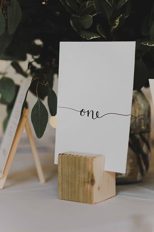 """Image by <a class=""""text-taupe-100"""" href=""""https://www.emisweddings.com"""" target=""""_blank"""">Emis Weddings</a>."""
