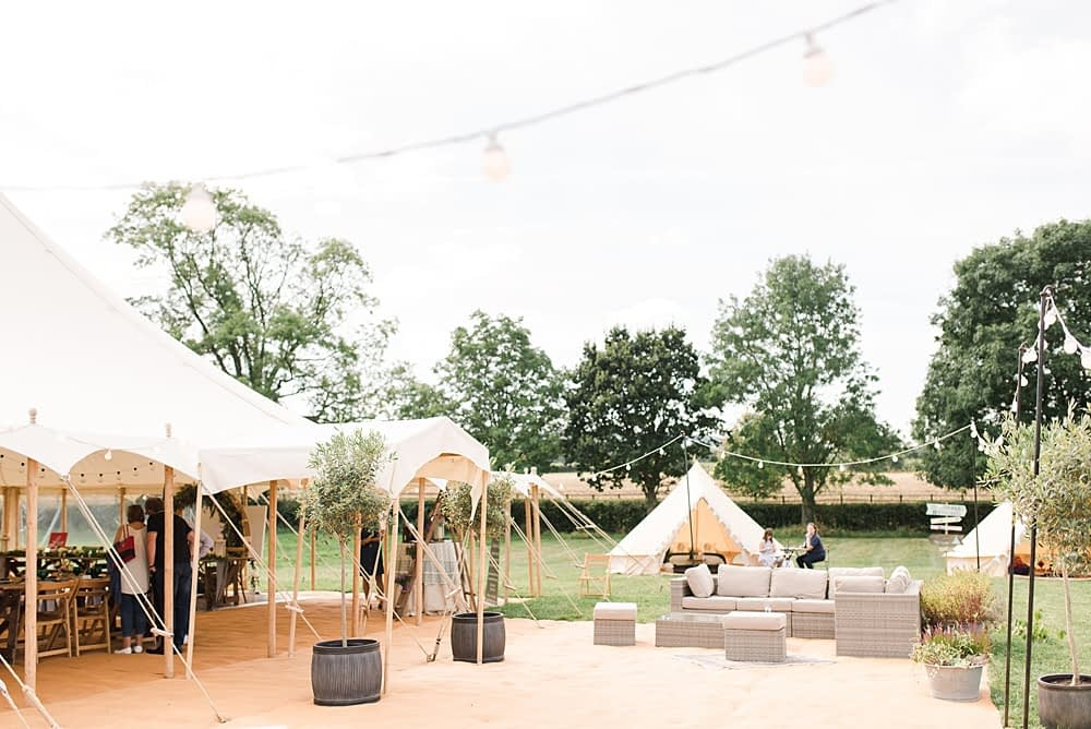 """Image by <a class=""""text-taupe-100"""" href=""""http://www.capturedbykatrina.co.uk"""" target=""""_blank"""">Captured by Katrina</a> with <a class=""""text-taupe-100"""" href=""""https://cocoweddingvenues.co.uk/coco_listing/boutique-marquees/"""" target=""""_blank"""">Boutique Marquees</a>."""