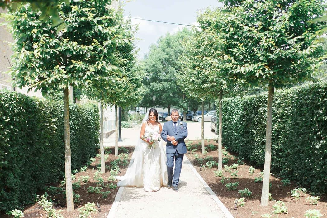"""Image by <a class=""""text-taupe-100"""" href=""""http://www.whitestagweddings.com"""" target=""""_blank"""">White Stag Wedding Photography</a>."""