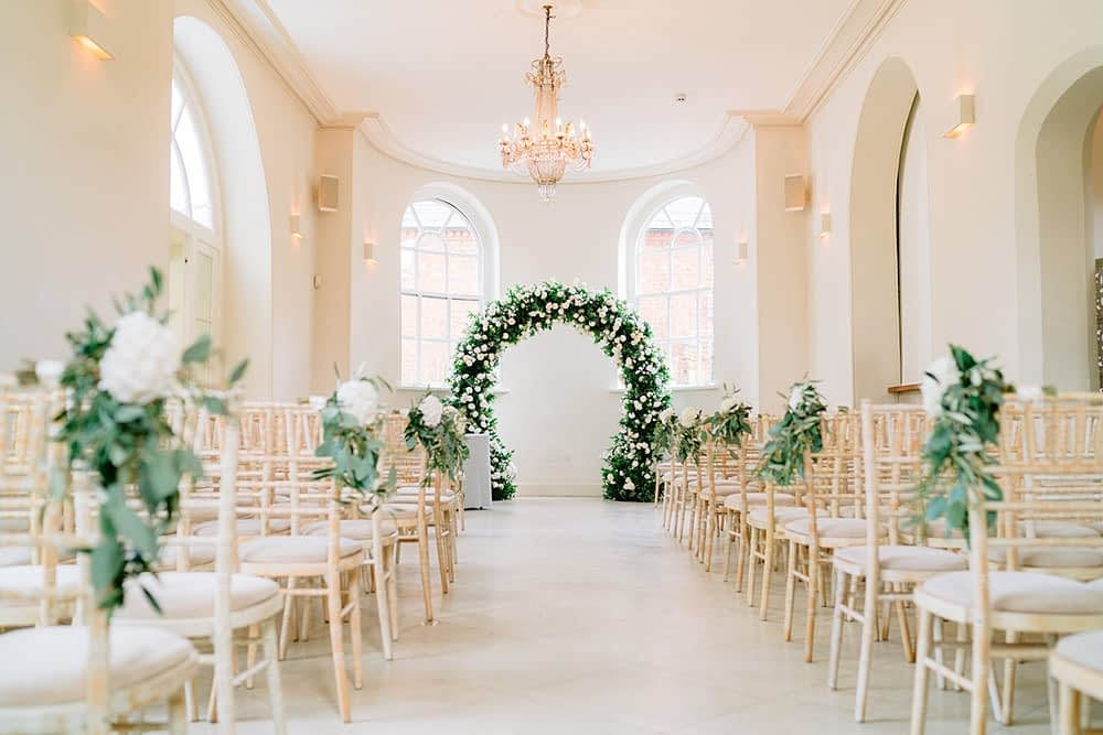 """Image by <a class=""""text-taupe-100"""" href=""""https://www.tobiahtayo.com"""" target=""""_blank"""">Tobiah Tayo</a> at <a class=""""text-taupe-100"""" href=""""https://cocoweddingvenues.co.uk/coco_listing/iscoyd-park/"""" target=""""_blank"""">Iscoyd Park</a>."""