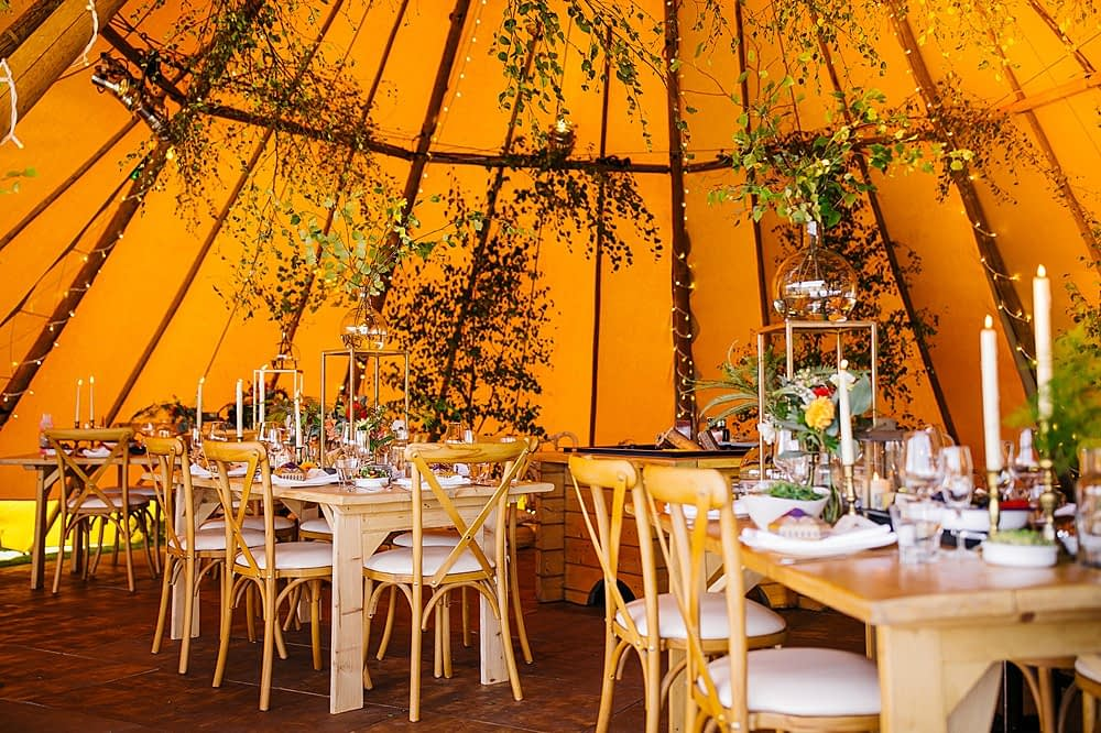"""Image by <a class=""""text-taupe-100"""" href=""""http://www.nickrutterphotography.co.uk"""" target=""""_blank"""">Nick Rutter Photography</a>   Tent Supplier <a class=""""text-taupe-100"""" href=""""https://cocoweddingvenues.co.uk/coco_listing/coastal-tents/"""" target=""""_blank"""">Coastal Tents</a>."""