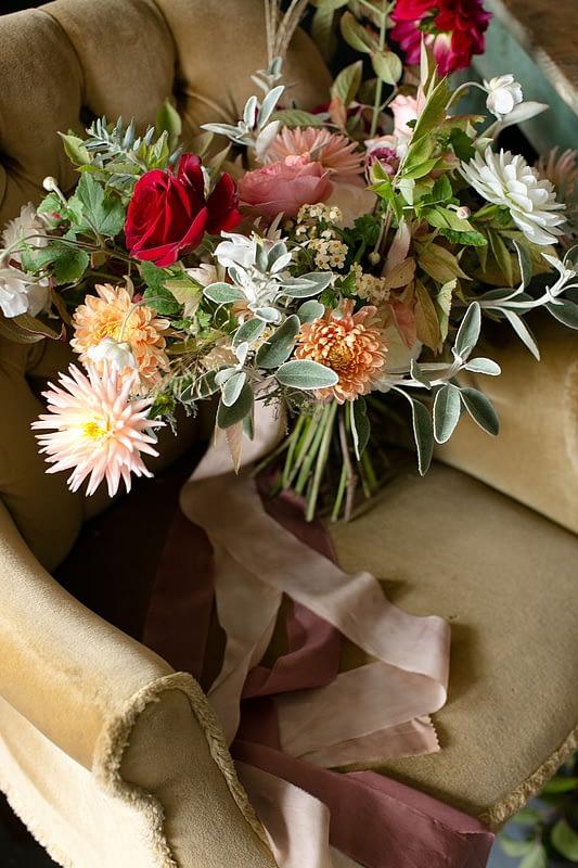 "Image by <a class=""text-taupe-100"" href=""http://www.corettefauxphotography.co.uk"" target=""_blank"">Corette Faux Photography</a> | Flowers by <a class=""text-taupe-100"" href=""https://jennibloom.com"" target=""_blank"">Jenni Bloom Floral Design Studio</a>."