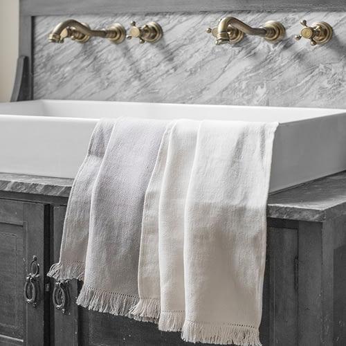 The Linen Works Motte Fringe Hand Towel, Chalk - £26.00.